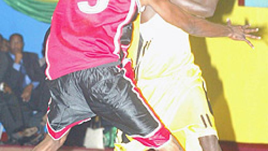 Former Marines captain Fiston Muhire (with the ball) now plays his trade with KBC. (File photo)