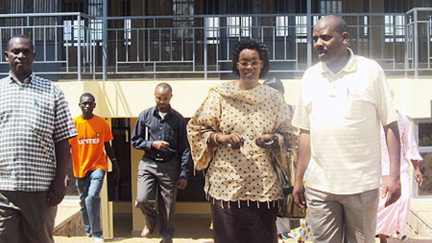 Ngoma district official inspecting the newly completed market in Kibungo town. Photo S. Rwembeho.