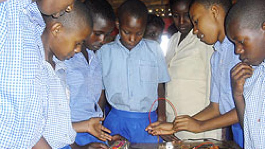 Pupils of Kivugiza primary school  constructing an electric circuit during a practical lesson (Photo. C. Kwizera)
