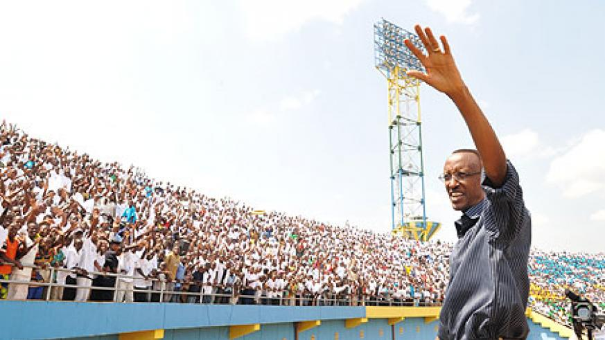 President Paul Kagame waves at the youth during yesterday's celebrations at Amahoro stadium (Photo/ Urugwiro Village )