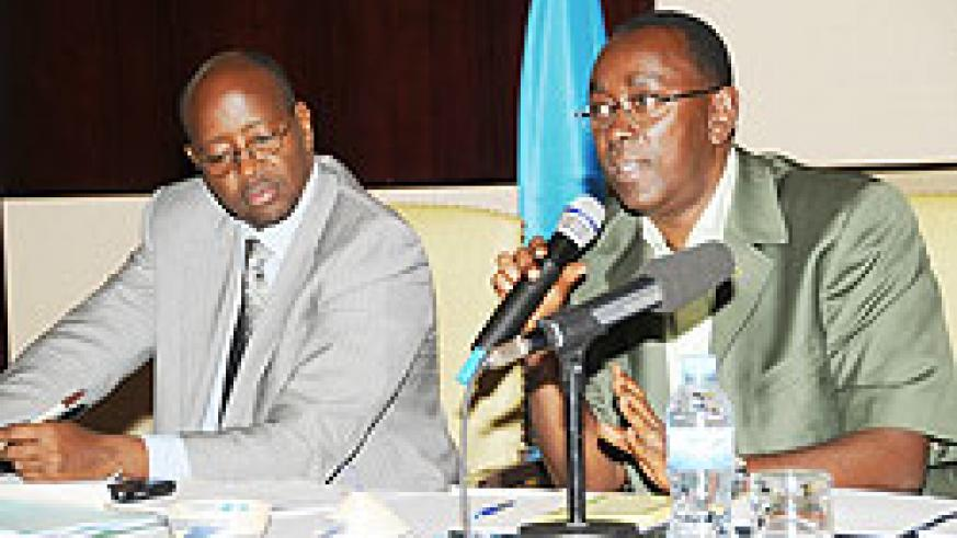 Prime Minister Bernard Makuza (R) speaks at the Central - Local Government meeting as Local Government Minister James Musoni takes notes yesterday. (Photo J Mbanda)