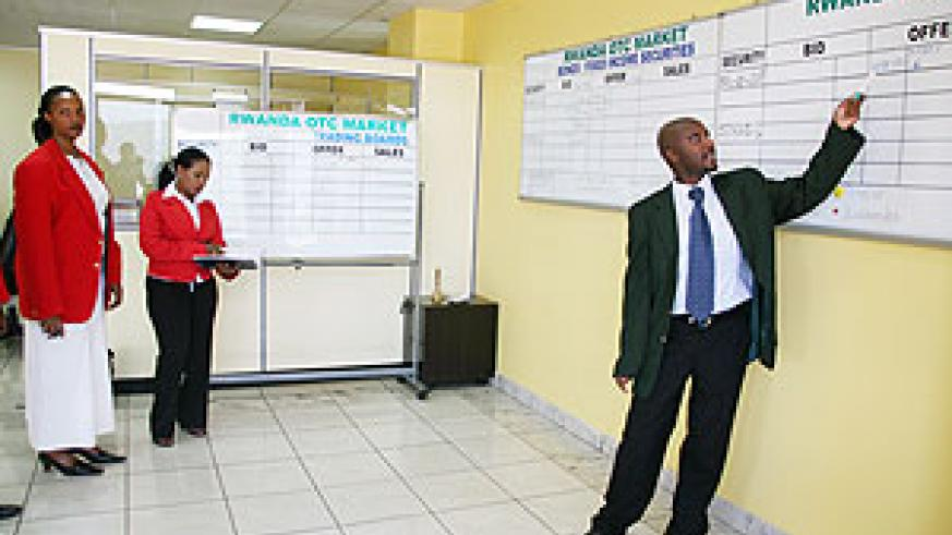 Celestin Rwabukumba, CMAC's  Operations Manager conducting trading at the Rwanda OTC market