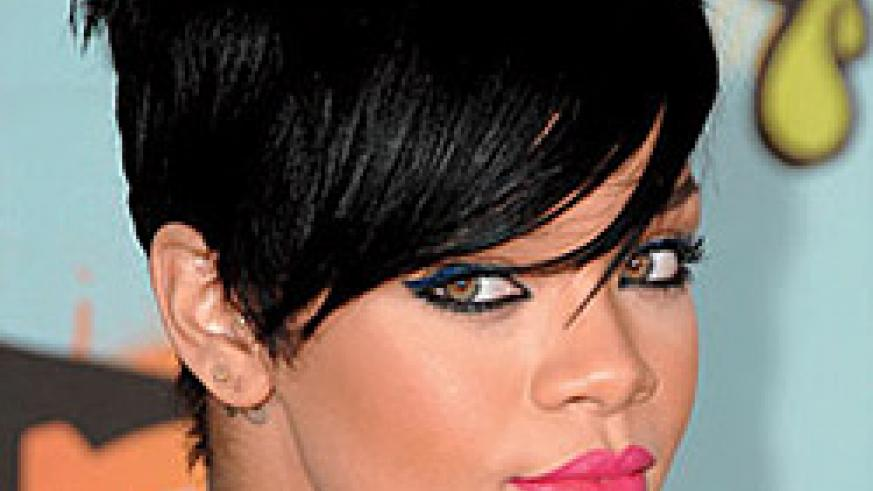 Edgy looking Rihanna with Bangs. This hair style is the inthing.