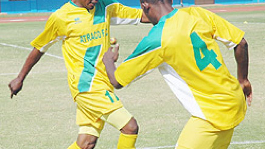 Atraco captain Jean Lomami (L) with a team mate shortly before a Primus League encounter. (File photo)