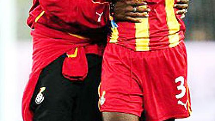 Asamoah Gyan is consoled by a teammate after he missed the penalty that would've given Ghana a win in normal time. (Net photo)