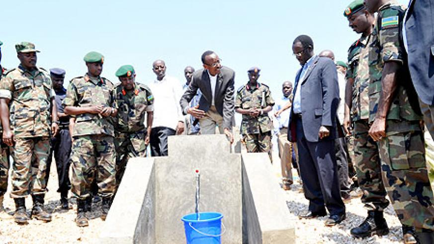 President Paul Kagame commissioning a piped water project constructed during the just concluded Army Week in Muhanga yesterday (Photo / J. Mbanda )