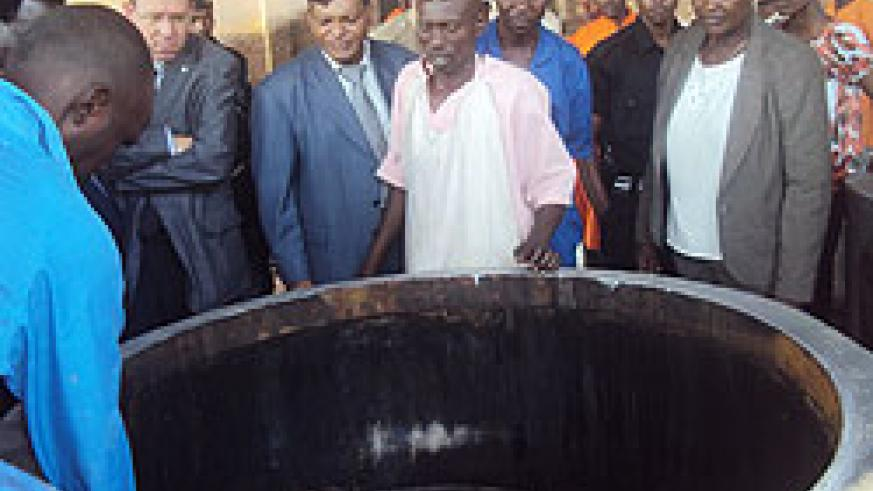 Mary Gahonzire (extreme left) and other officials observing the new biogas facility (Photo; S. Rwembeho)