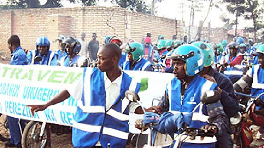 Muhanga motorcyclists parade in their new uniform donated by the Electoral Commission. (Photo D. Sabiiti)