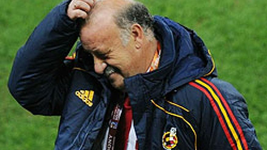 Spain's coach Vicente Del Bosque scratches his head during the 2010 World Cup semi-final football