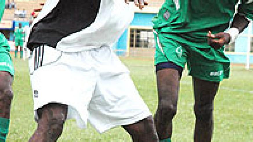 Rassou battles for the ball with SC Kiyovu players. The striker didnot have a good season. (File Photo)