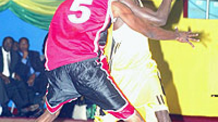 KBC's Fiston Muhire (with the ball) averaged 20 points in the first round. (File Photo)