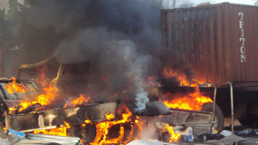 The truck caught fire after the accident. (Photo by S. Rwembeho)