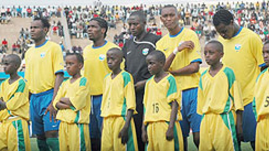 Amavubi players line up for a friendly match against Tanzania last year. (File photo)