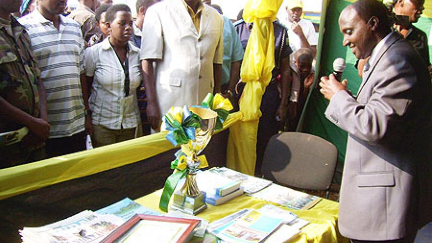 Gicumbi Mayor Nyangezi, outlines the district's achievements while addressing guests at the district exhibition stand. (Photo: A.Gahene)
