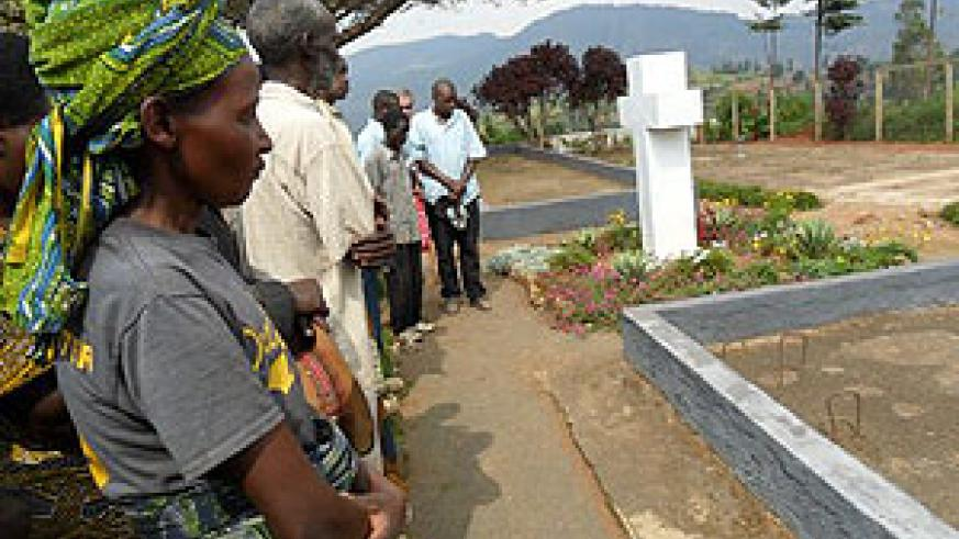 Survivors and members of RAFA pay respects to genocide victims at Karama genocide memorial site (Photo by J C Gakwaya)