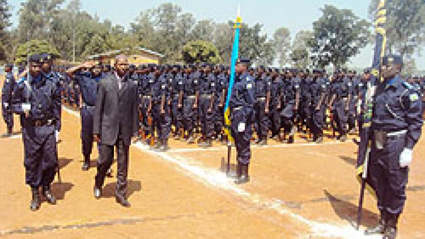 Minister Musa Fazil Harerimana inspecting a guard of honour mounted by the police constables who passed out yesterday (Photo; S. Rwembeho)