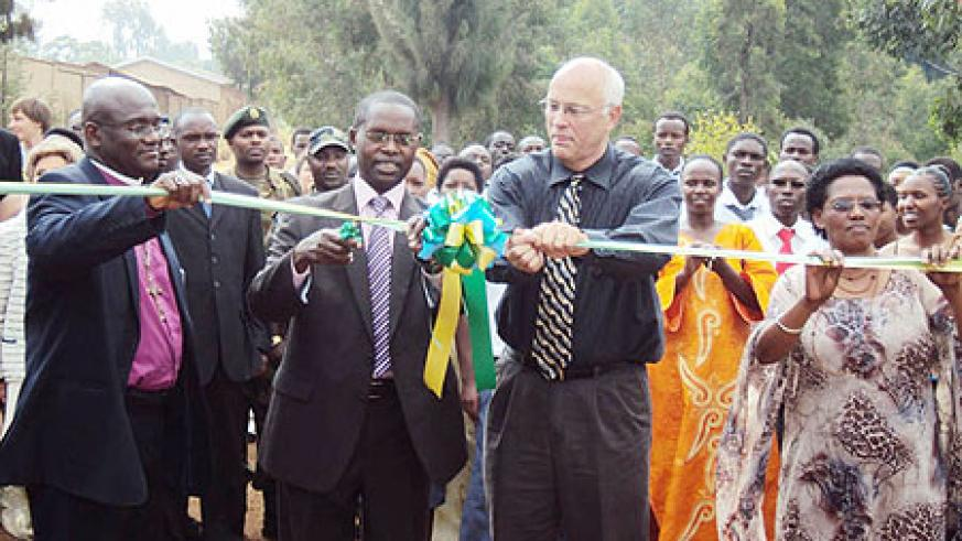 Dr. Matthias Harebamungu cutting the ribbon to commission new structures (Photo; D. Sabiiti)