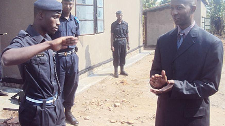 PC Abdoulkalim Kazoba salutes Minister Harerimana after he officially handed over the house to him. (Photo: S. Rwembeho)