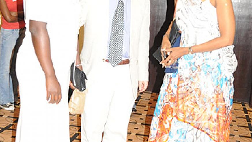 A perfect look, Claudine Murenzi (in a traditional dress)strikes a pose with friends at the event.