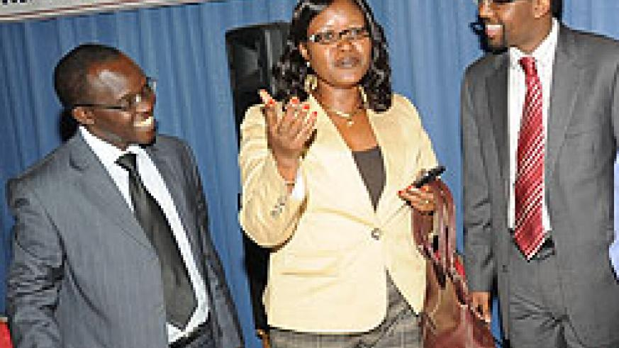 Minister for East African Community Monique Mukaruliza (C) talks to Gaspard Safari of ARJ and Faruk Osman of FAJ after opening the meeting yesterday. (Photo J Mbanda).
