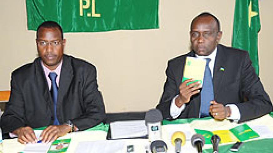 PL Presidential candidate Prosper Higiro (R) with the Party President Protais Mitali at the Press conference yesterday. (Photo J Mbanda)