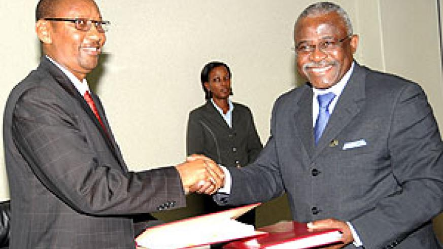 Finance Minister John Rwangombwa and IFAD President Dr. Kanayo Nwanze after signing. (Photo J Mbanda)
