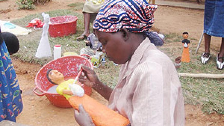 Busy at work. A woman busy paints her artifact.