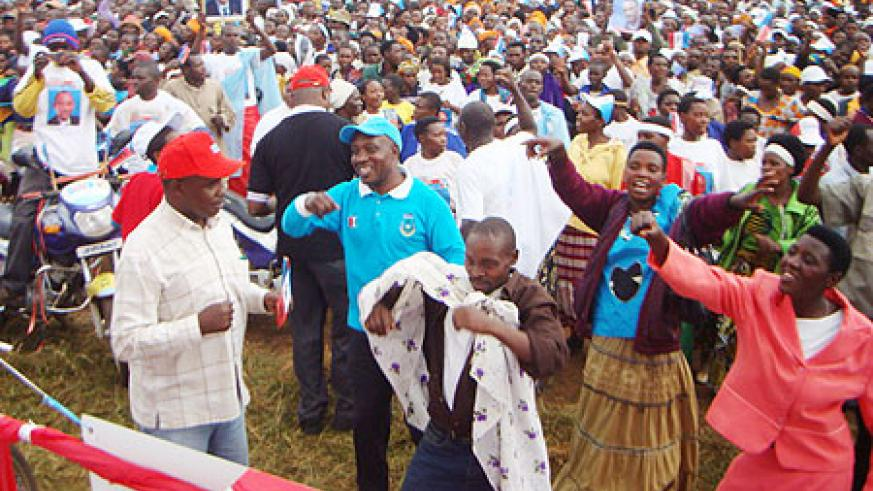 RPF supporters chant party slogans during rally at Cyumba Sector on Wednesday. (Photo by:   A.Gahene)