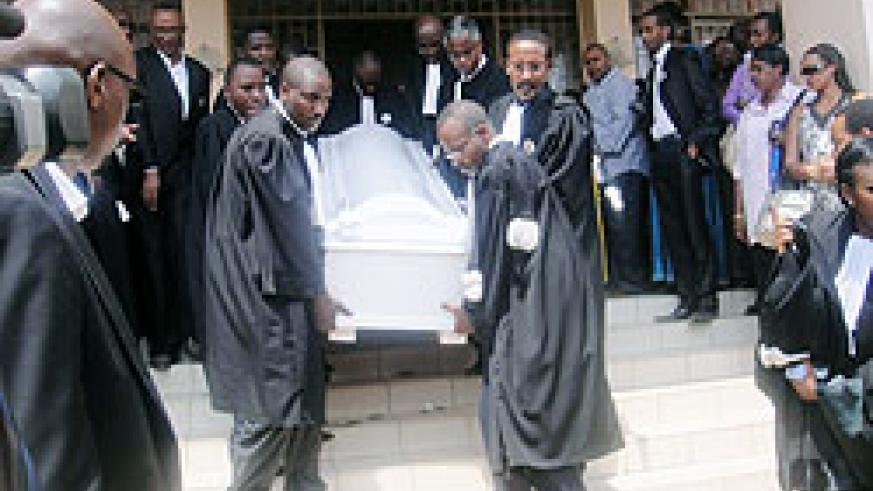 Colleagues carrying the coffin of former Bar chair Jean Haguma after he was honoured in the Supreme Court Chambers yesterday(Photo: Eugene Mutara)