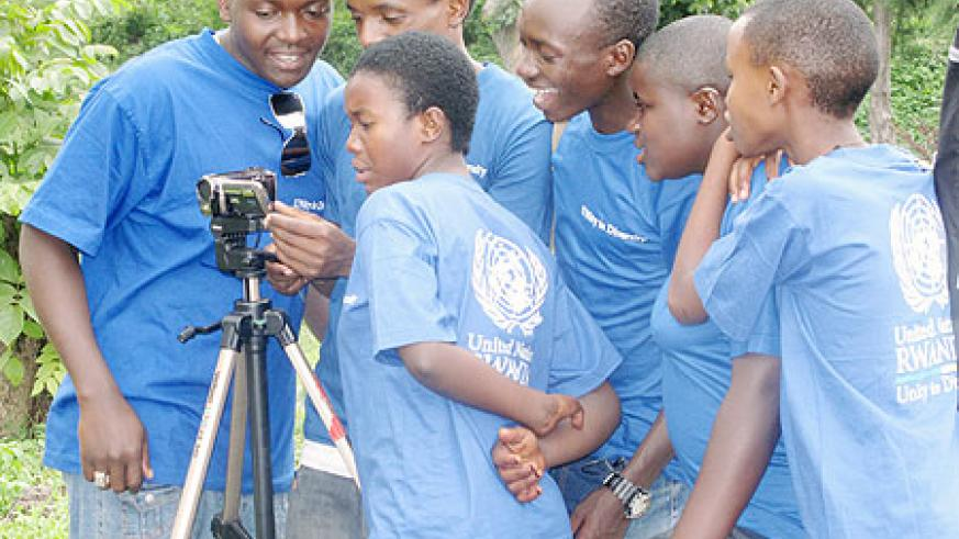 The youth during  practice of how to shoot a film scene.