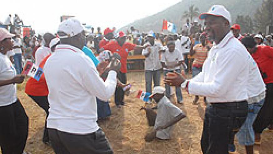 Wellars Gasamagera one of the RPF campaign committee members leads supporters in celebrations during the campaign launch in Nyarugenge district yesterday (Photo F Goodman)