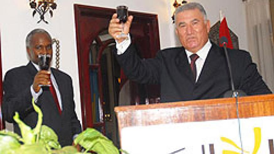Minister of Education, Charles Muligande, toasts with the Egyptian Ambassador, Ahmed Rami, during the celebrations at the Egyptian Embassy. (Photo F. Goodman)