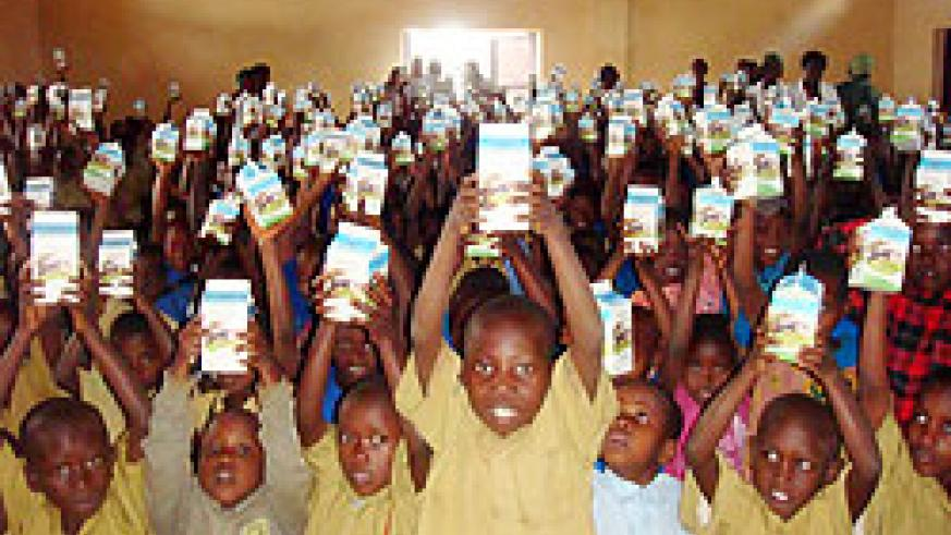 Pupils displaying pints of milk at one of the schools benefiting from the programme (Courtesy photo)