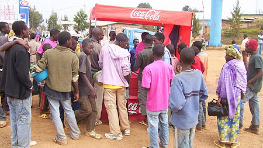 Byumba town residents gather at Cocacola mobile kiosk to buy the new Fanta Fiesta on Saturday. (photo/A.Gahene)