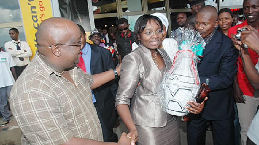 John Bosco Gasasira, the editor of Umuvugizi newspaper, welcoming Victoire Ingabire at the airport