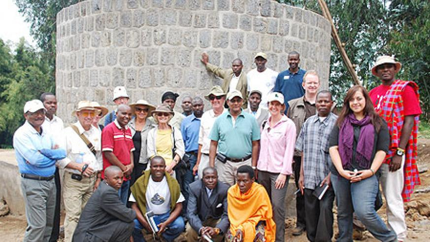 Karisoke Research Centre staff and residents pose for group photo in front of the newly built tank in Bisate (Courtesy photo)
