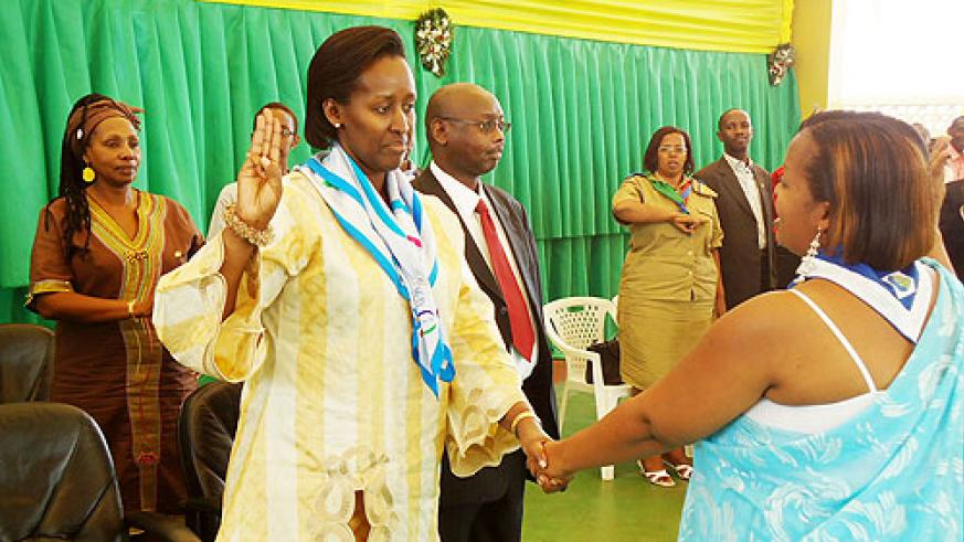 'Once a Guide, always a Guide'. Mrs. Jeannette Kagame takes a guides salut with AGR boss Alexia Nkurunzinza yesterday (Courtsey Photo)