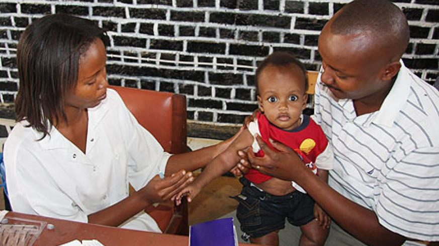 Jean Pierre Rwigamba is one of the fathers who turned up with his son Kecy Rwigamba for immunisation in Bugesera district. (Photo by Sam Nkurunziza)