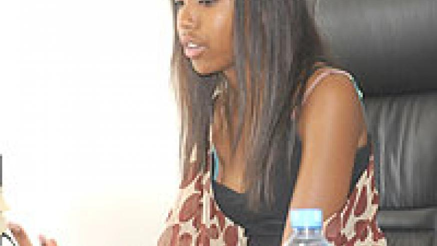 Keza Ruzima in an interview after handing over her donation to the One Dollar Campaign (Photo F Goodman)