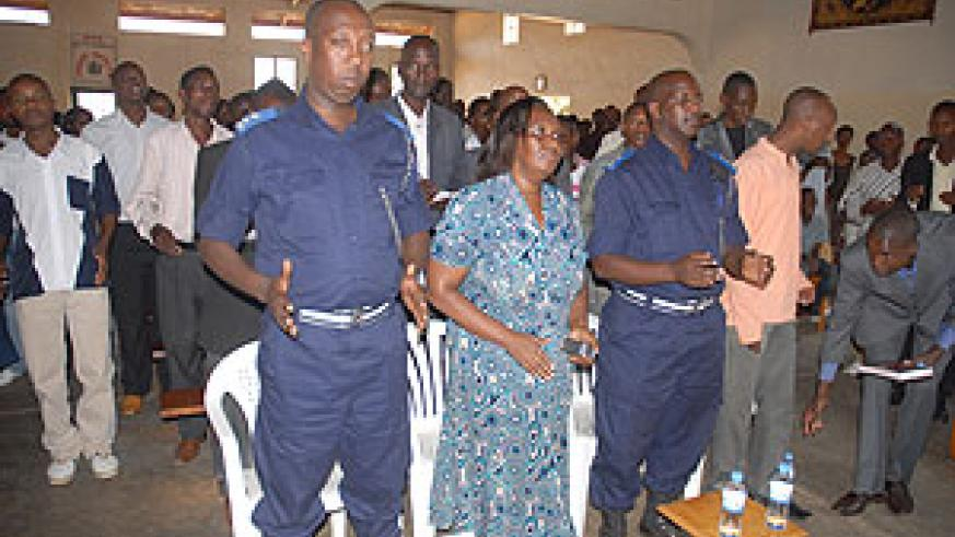 Police officers from the Gender Desk join Christian youth during the conference yesterday ( photo by F. Goodman )