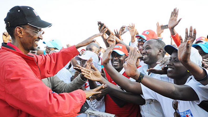 Kagame greets cheerful RPF supporters at a campaign rally, yesterday (Photo: Adam Scotti)