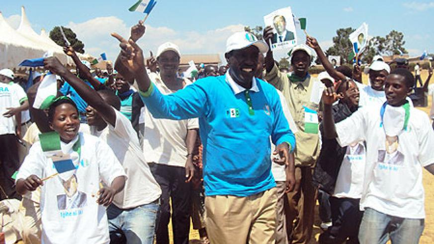 PSD candidate sharing a light moment with supporters in Karenge sector.