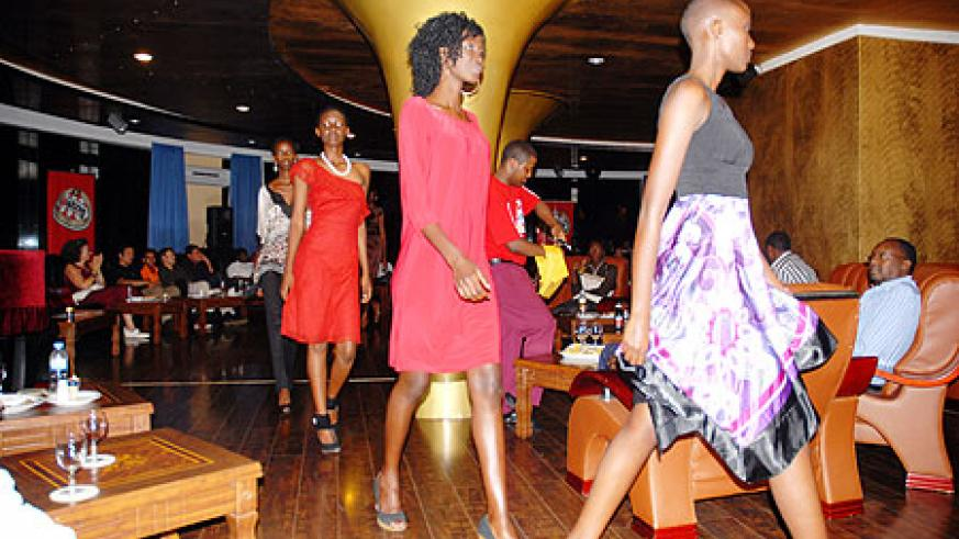 A cross selection of Rwandan and Kenyan models do a catwalk during the event.