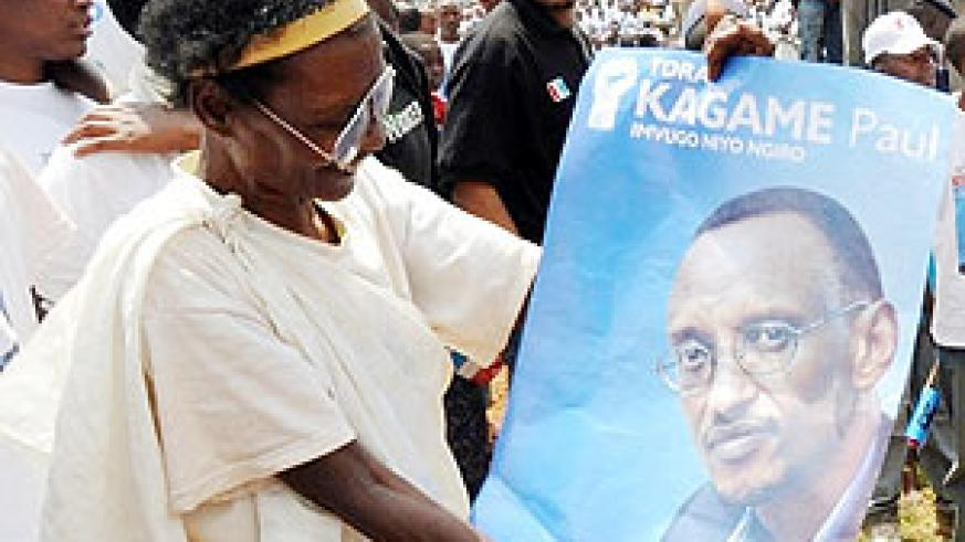 An elderly  Gicumbi woman shows off her  admiration for Kagame