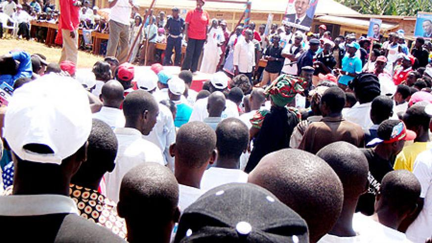 Prime Minister Makuza (in white top) campaigns for Kagame in Tumba Sector, Huye district yesterday. (Photo P. Ntambara)