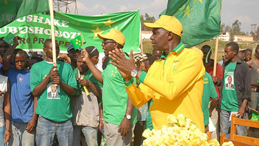 PL Presidential candidate, Prosper Higiro, leads party supporters through a party song during his rally in Gisozi (Photo F Goodman)