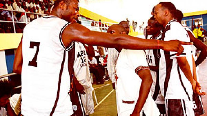 Cliff Owour (C) listens to his players during final of last year's Gisembe memorial tournament, which they won. He will hoping that his team can stay in pole position to retain the league crown. (File photo)