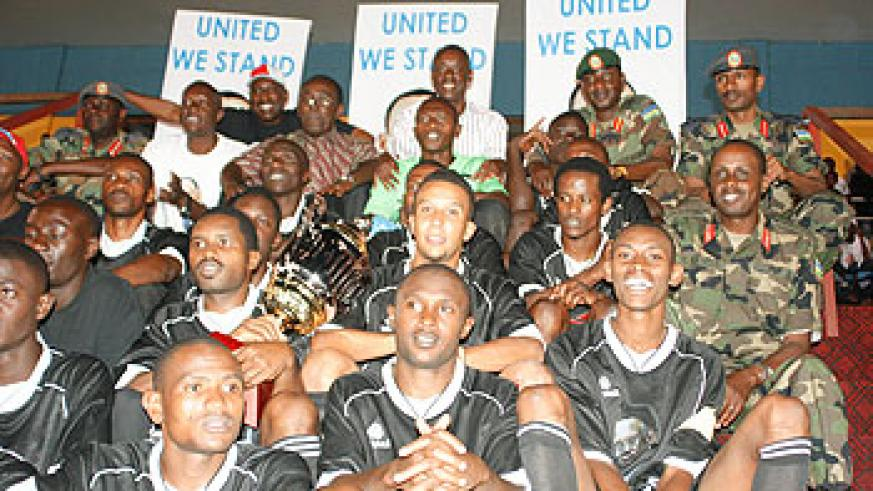 Prime Minister Bernard Makuza (Centre back row) joins APR football club in celebrations after they won the United We Stand Tournament trophy.(Photo: G. Kirenga)