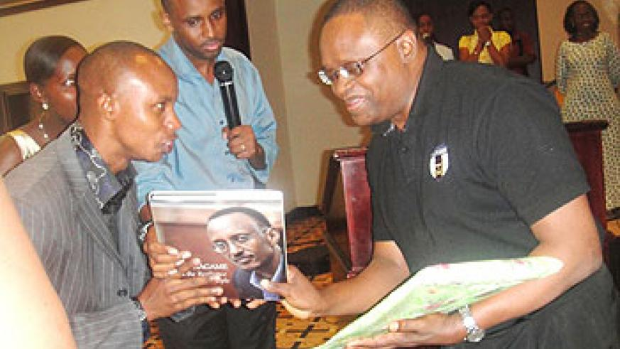 Youth presents gifts to Prof. Vicent C. Anigbogu in appreciation for inspiring them(Photo Eugene Mutara)