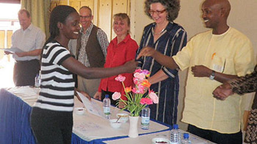 One of the participants being awarded a certificate ( Photo by Ninsiima Innocent)